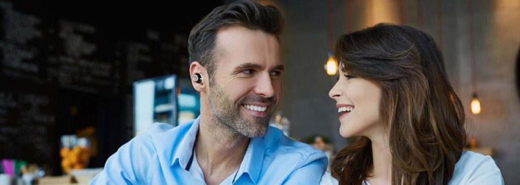 Nuheara Truly Wireless Earbuds in a Bar